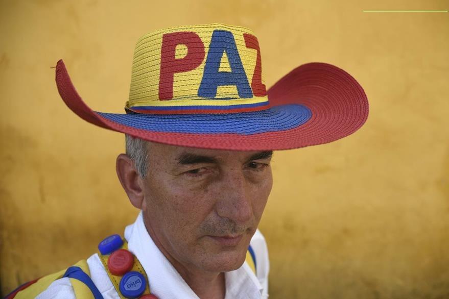 Según encuestas, el 54% de los colombianos está de acuerdo con la firma de la paz. (Foto Prensa Libre: AFP).