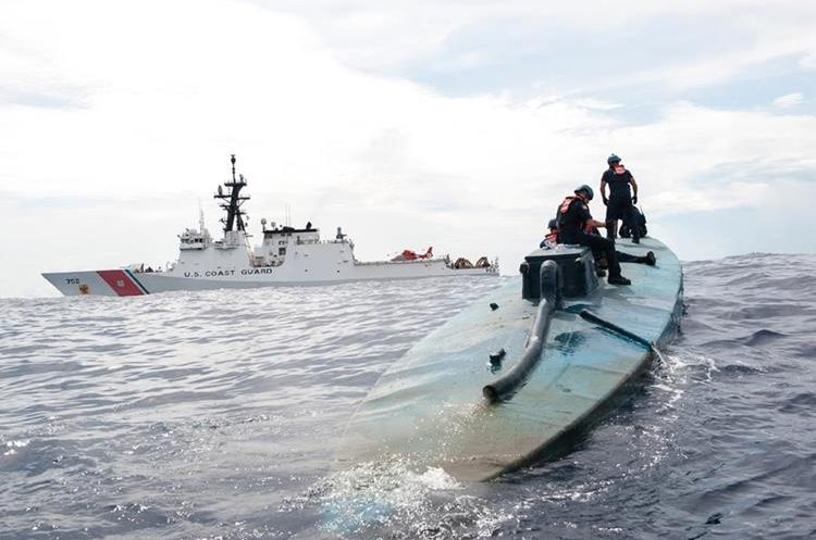 In this July 19, 2015 photo released by the U.S. Coast Guard, a Coast Guard Cutter Stratton boarding team investigates a self-propelled semi-submersible in international waters off the coast of Central America. The seizure of around 12,000 pounds of cocaine from the vessel was one of the largest busts of its kind. (Petty Officer 2nd Class LaNola Stone/U.S. Coast Guard via AP)