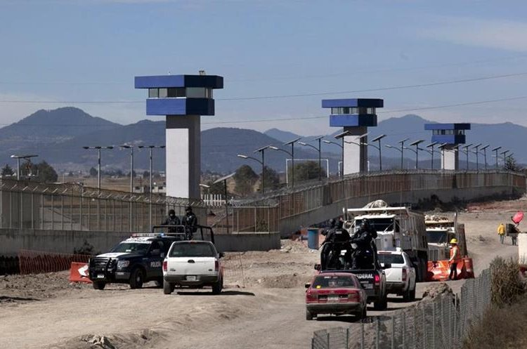 """Federal Police patrol on the perimeters of the Altiplano maximum security prison in Almoloya, west of Mexico City, Saturday, Jan. 9, 2016, where Joaquin """"El Chapo"""" Guzman, head of the Sinaloa drug cartel, is being held after his recapture on Friday. Guzman was sent back to the maximum-security prison from where he escaped last July 11 through an elaborate tunnel that was dug to shower stall. (AP Photo/Marco Ugarte)"""