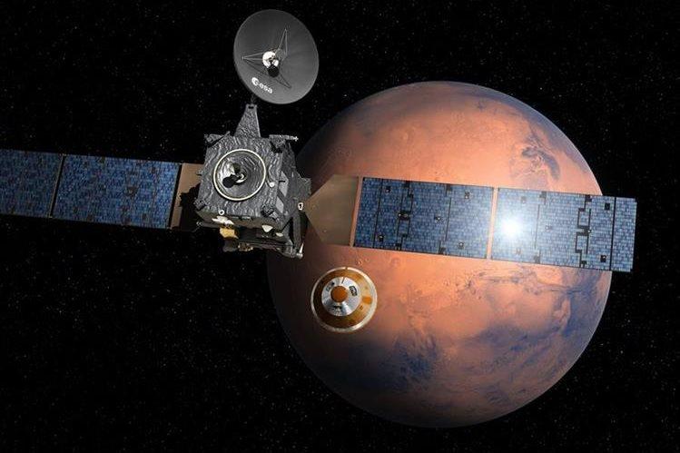 Foto artística proporcionada por ESA muestra como pudo haber sido la separación de módulo del satélite orbitador sobre Marte. (Foto Prensa Libre: AFP)